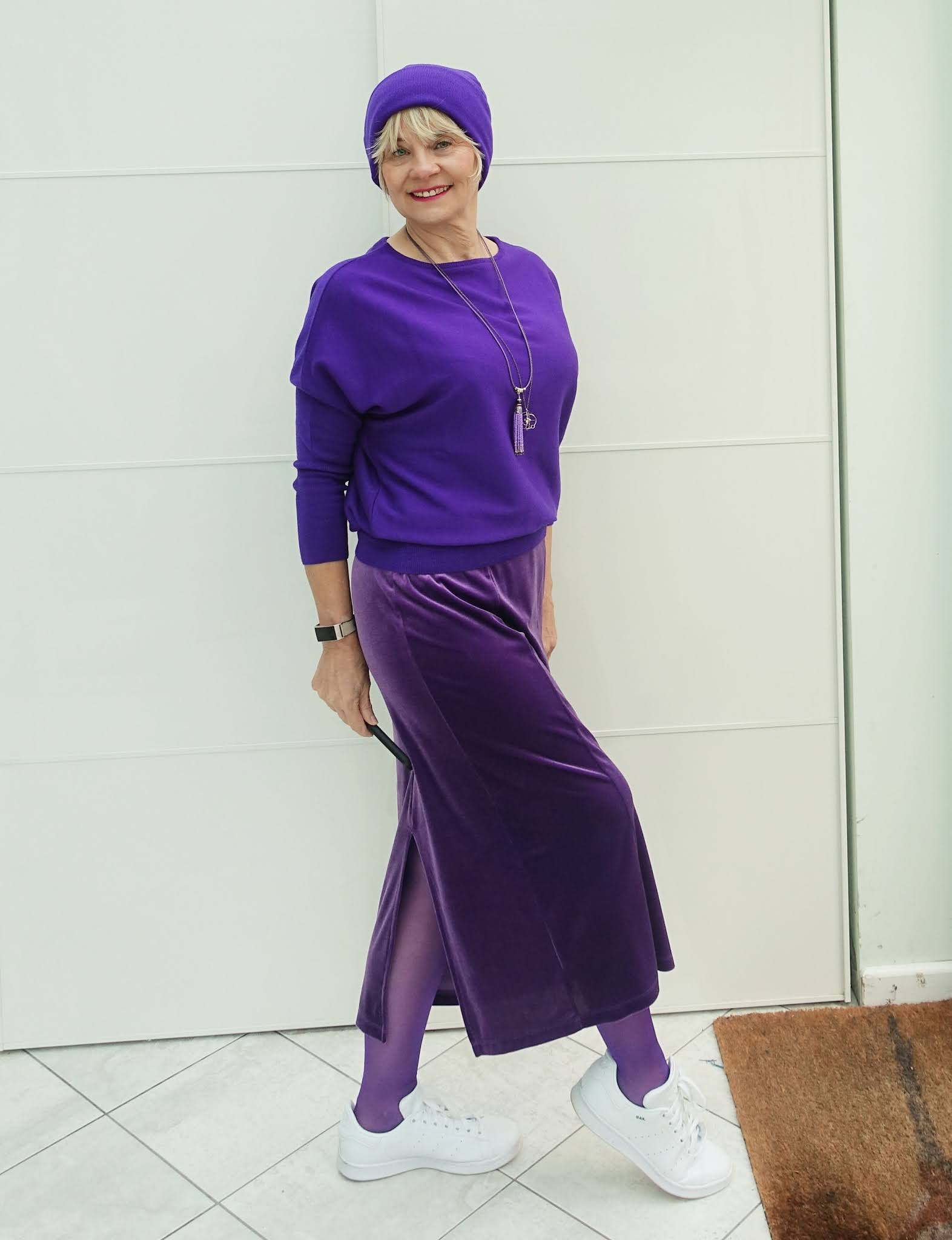 A purple merino beanie adds an Abba-esque touch to a monochrome purple outfit for Is This Mutton blogger Gail Hanlon