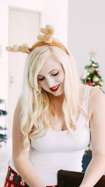 Fashion and Travel Blogger GlobalFashionGal (Brianna Degaston) decorates her Singapore apartment for Christmas with reindeer antlers.
