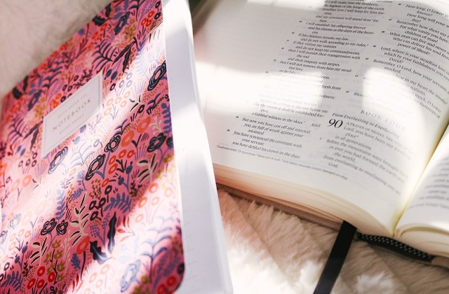 bible and pink notebook
