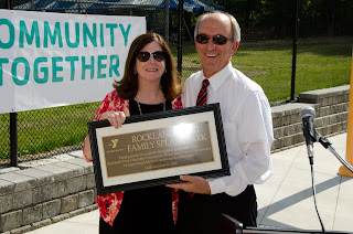 Jane Lundquist, executive vice president of Rockland Trust, and Ed Hurley, president of the Hockomock Area YMCA, with the Rockland Trust Family Splash Park dedication plaque