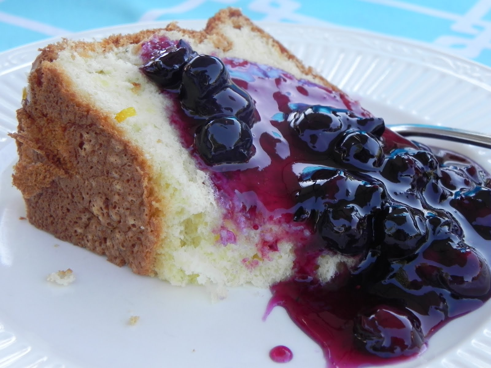 Chinese Angel Food Cake With Tart Lemon Glaze And A Warm Blueberry Sauce