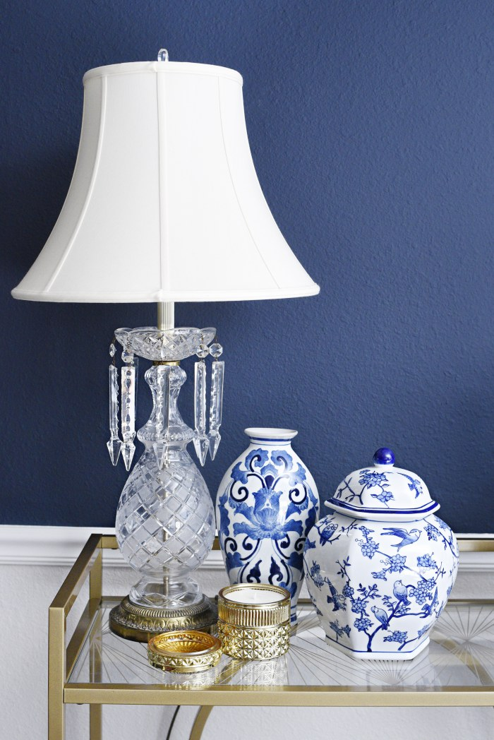 Tips for shopping for home decor/interiors at an estate sale. This gold and glass lamp is one of the blogger's finds! | via monicawantsit.com