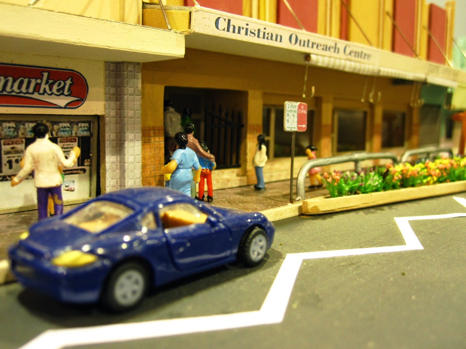 Quarter inch scale modern Australian town street scene with supermarket and Christian Outreach Centre.