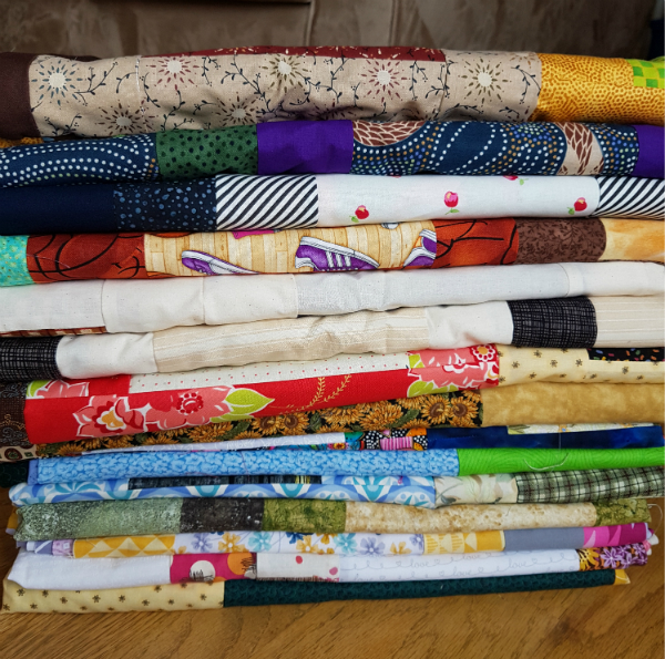 Stack of quilt tops | DevotedQuilter.blogspot.com