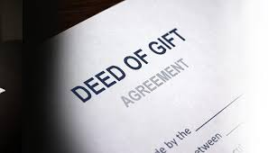 This is a multilateral agreement between two or more people which voluntarily transfers ownership of the property from one person to another without involving money as a consideration. Deed of gift is an agreement, but the uniqueness of this agreement is that it uses NATURAL LOVE AND AFFECTION as its consideration. The party who transfer his/her property is called donor and the other to whom property is transferred is called donee.