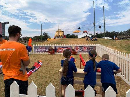 Nerf Fest 2019 - girls preparing to shoot with Nerf Blasters