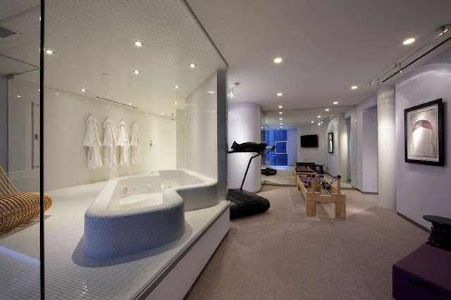 in home gym with cool bathtub