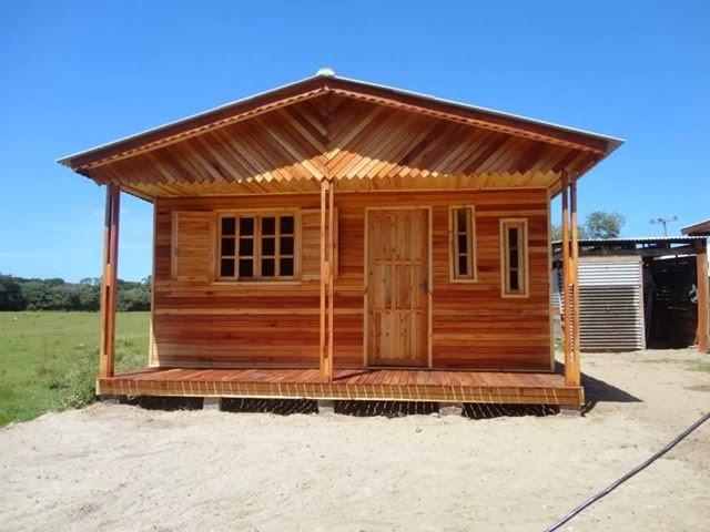 Casa de madeira casas sem pinturas for Como elegir pintura para casa