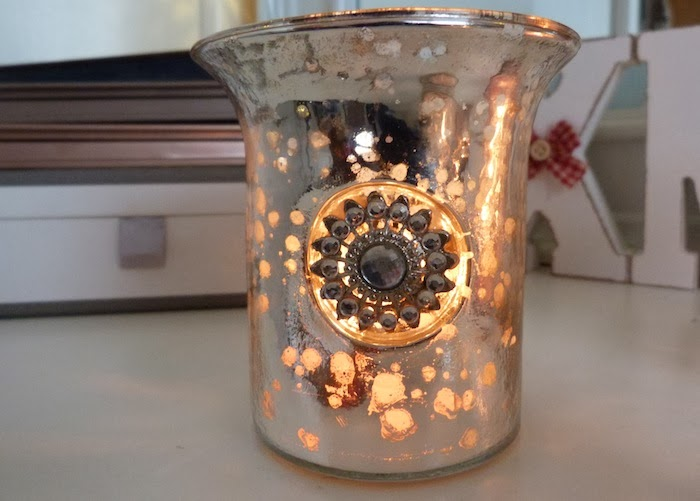an image of antique gem candle holder