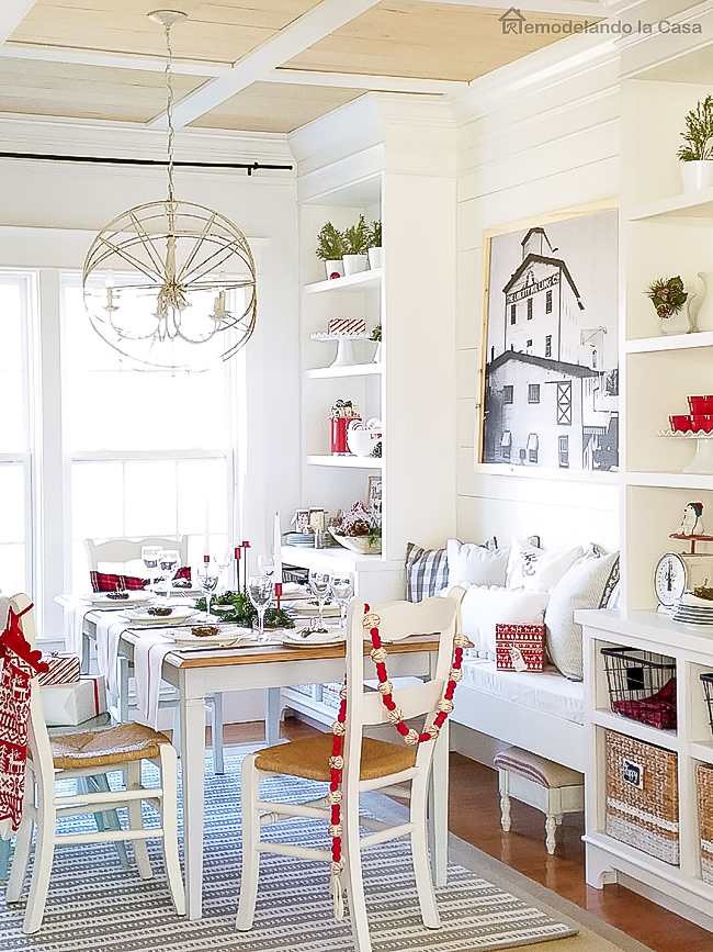 Dining room decorated for Christmas with red, white and wooden tones. Simple holiday decor.