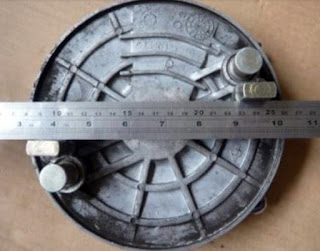 Ruler laid across interior of brake plate.