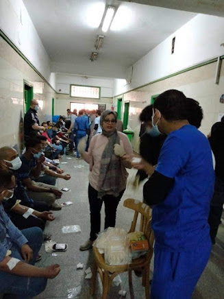 Blood donors sitting on the floor in a  Sohag hospital