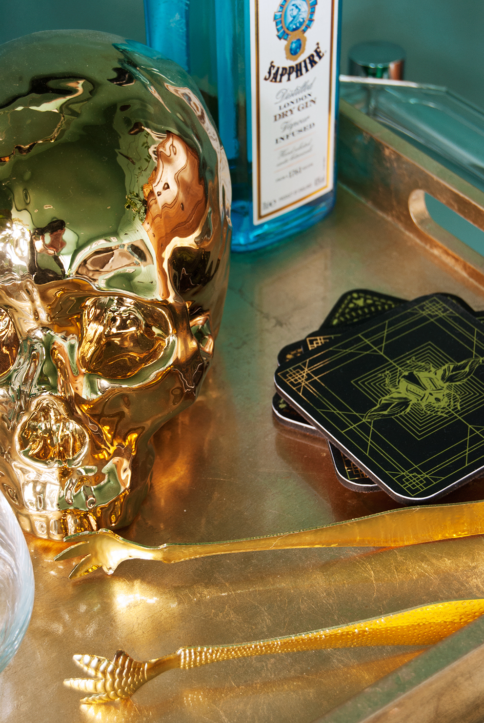 Family TV Room Reveal - French For Pineapple Blog - Gold Skull, Gin Bottle and Coasters
