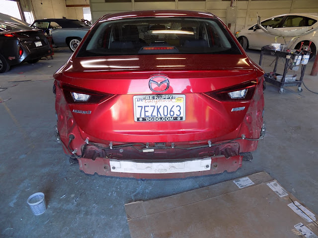 Mazda 3 during repairs at Almost Everything Auto Body.