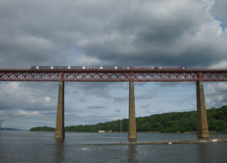 Train traversing the Forth Bridge, South Queensferry, Scotland