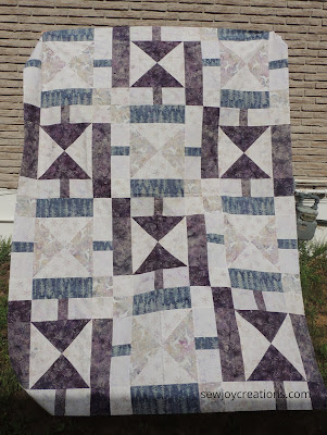Sunbeams quilt pattern done in Plum Pudding fabrics