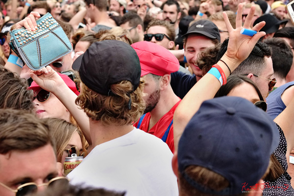Super Mario (red caps) tries to get through - blue bag blue lighter. Harbour Life Music Festival Sydney 2016. Photographed by Kent Johnson for Street Fashion Sydney.