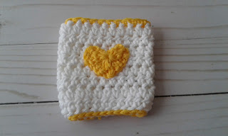coffee cup sleeve with yellow heart