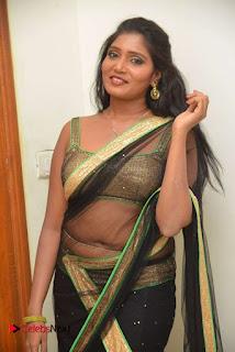 Actress Eeesha Chamundi Pictures in Black Transparent Saree  0010.jpg
