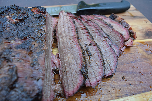 Smoked brisket on a ceramic kamado grill like the big green egg, grill dome, or kamado joe.