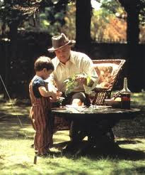 Marlon Brando as The Godfather playing with his grandson movieloversreviews.filminspector.com