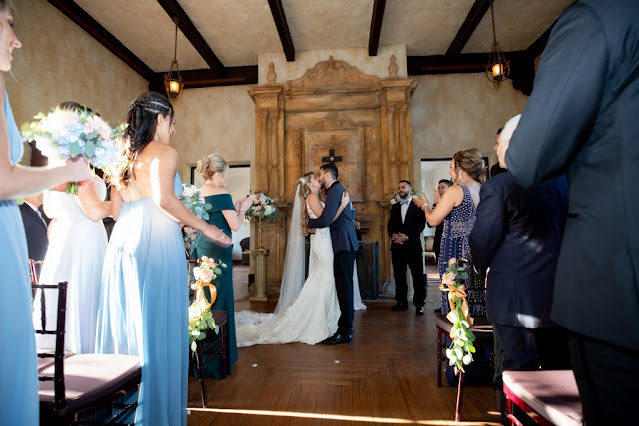 bride and groom kiss in ceremony at the howey mansion