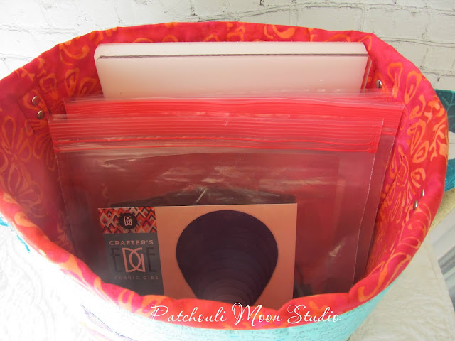 Inside look at fabric container holding plastic bags of cutting dies