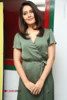Actress Raashi Khanna Stills in Green Short Dress at Mirchi 95 Suno Aur Mercedes Jeeto Contest  0107.JPG