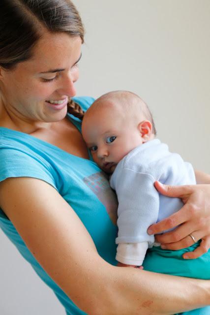 Mum carrying baby
