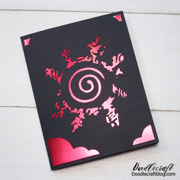 "Search for ""insert card"" on Cricut Design Space and pick a folded card with the corners you like. Then import the Naruto symbol and attach the image with the card. Then score and cut it out of cardstock. Finally insert a metallic piece of paper/poster board in the opening."