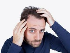 تساقط الشعر ما أسبابه وما علاجه؟