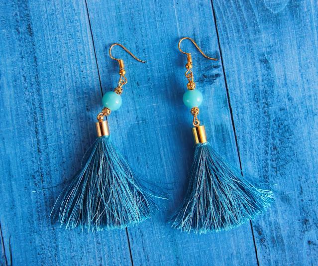 A pair of blue tassel earrings.