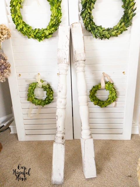 white shutters mantel boxwood wreaths