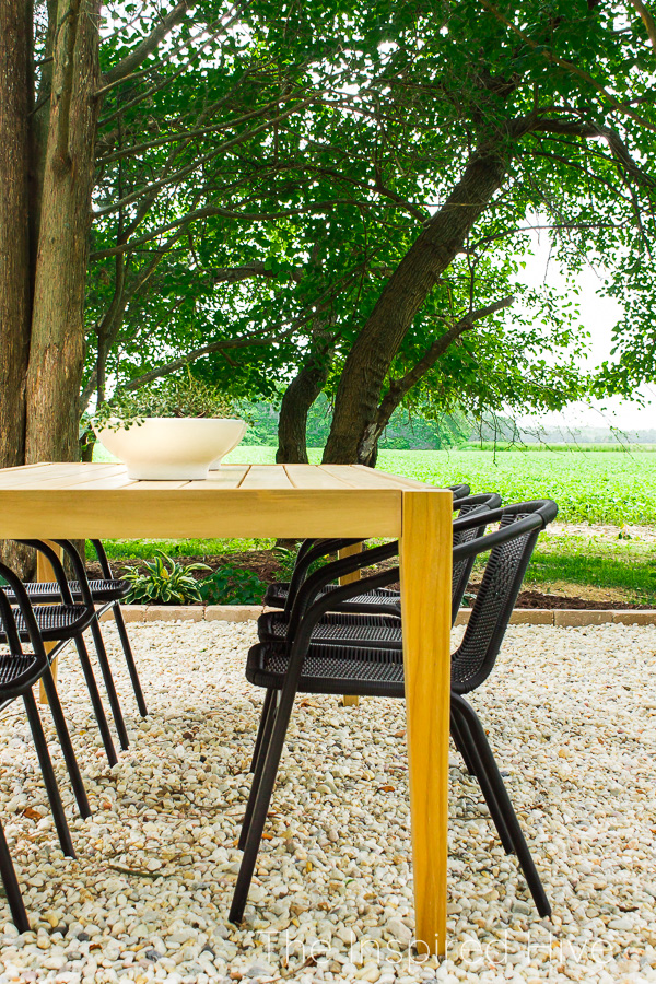 Gravel patio with teak dining table