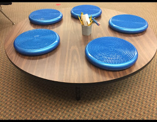 Low table and inflatable cushions in classroom