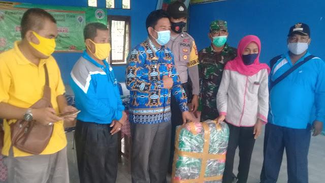 Desa Suka Maju Kecamatan Abung Semuli Bagikan 5000 Masker Kepada Masyarakat