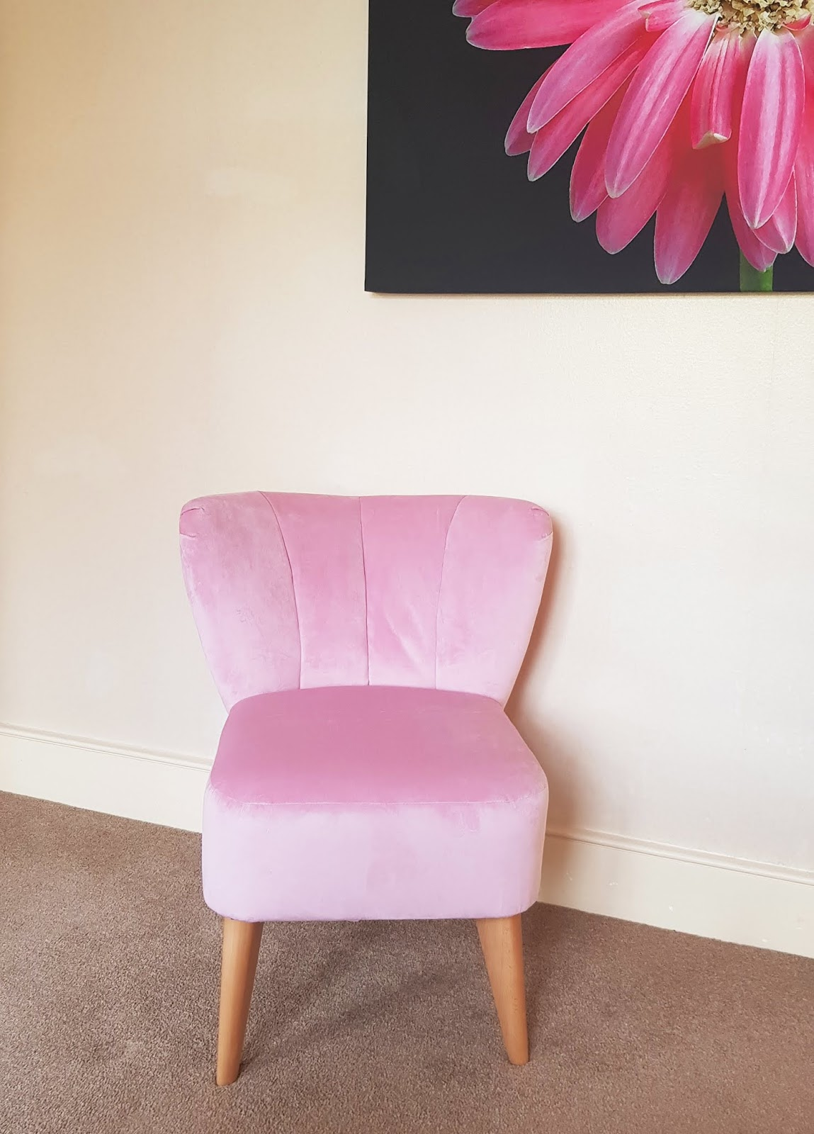 A contemporary pale pink armchair from Marks and Spencer
