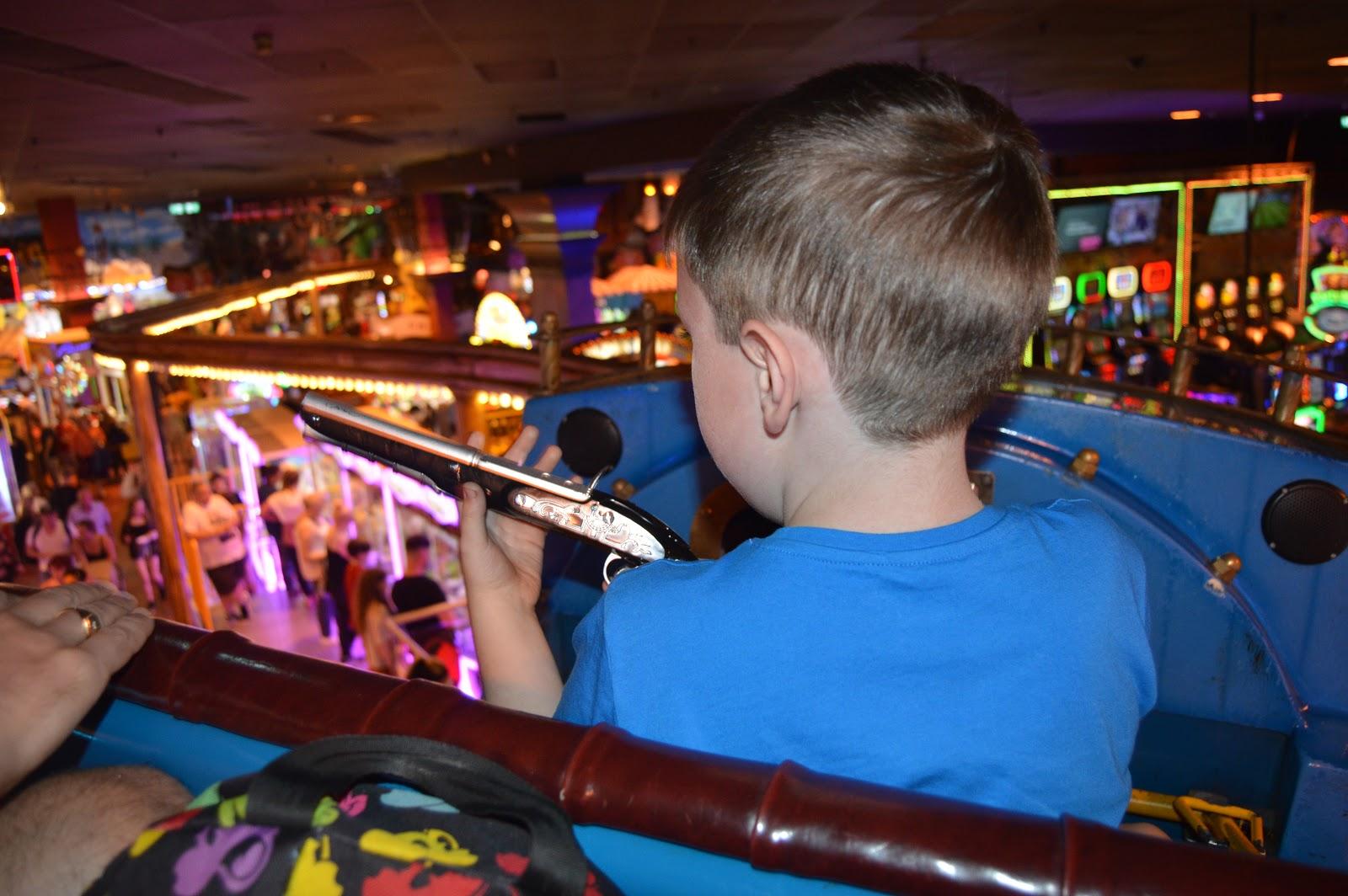 boy on ride in arcade