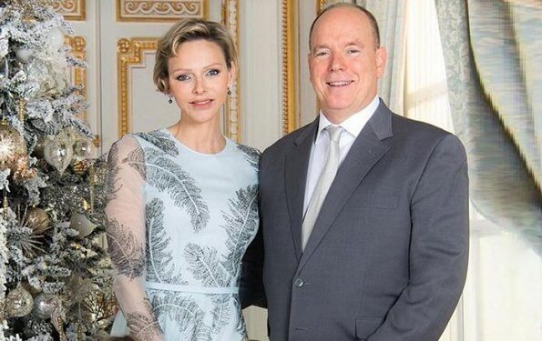 Princess Charlene wore a blue silk and embellished gown from Ralph & Russo. Ralph and Russo gunmetal feather embellished dress. Princess Gabriella