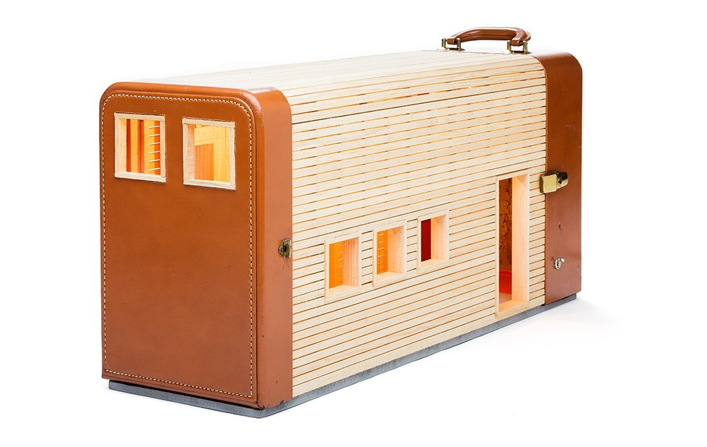 13-Migration-Ted-Lott-Architecture-in-Upcycled-Furniture-and-Suitcase-Sculptures-www-designstack-co