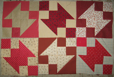 Buckeye Beauty quilt blocks in red and lights