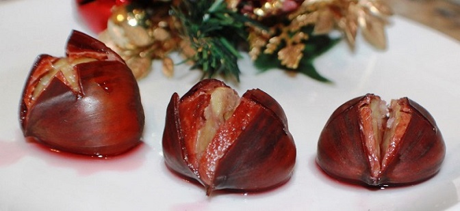 Merlot wine soaked chestnuts on a white plate
