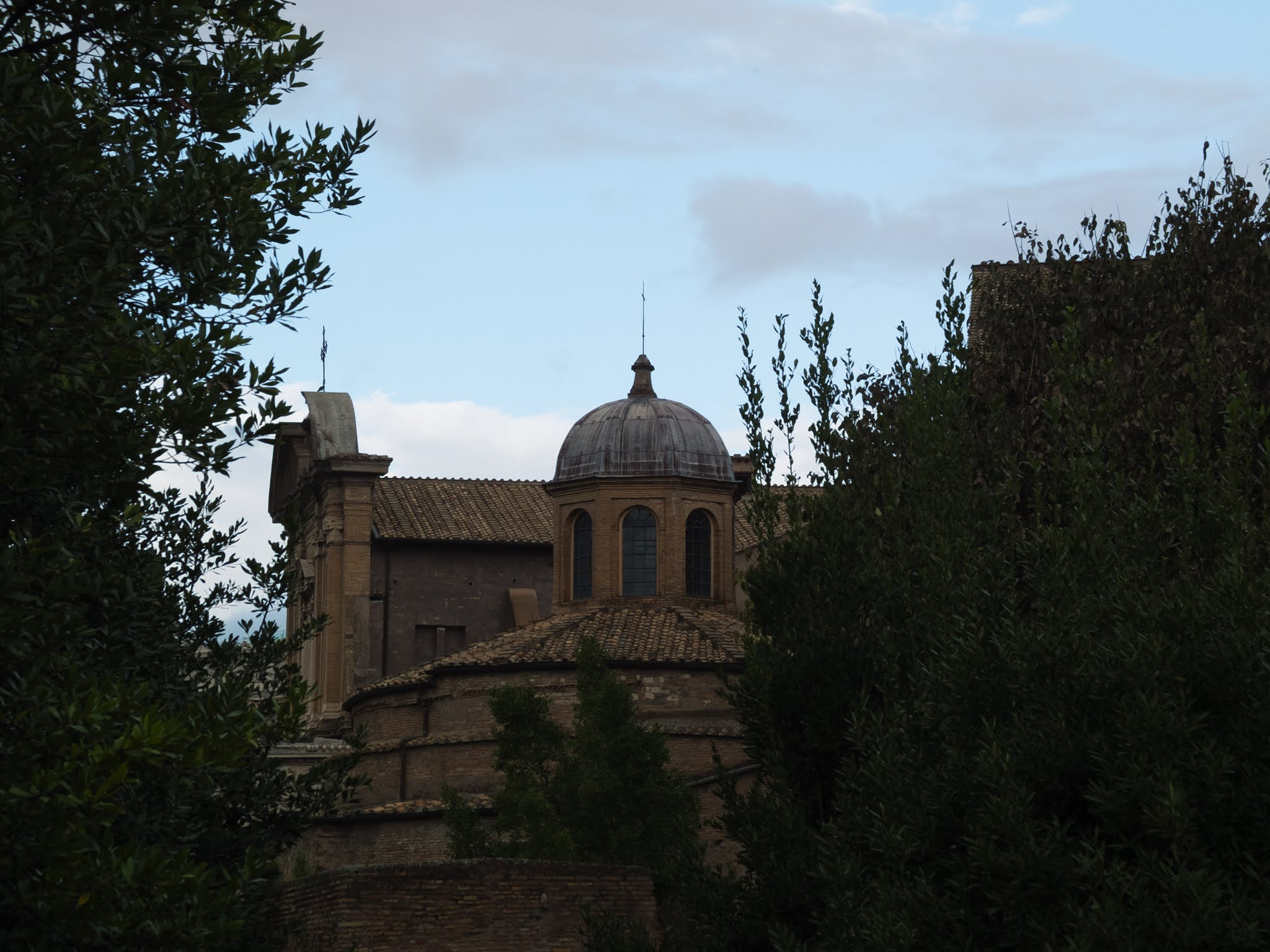 The dome of the Temple of Romulus and Remus surrounded by trees.