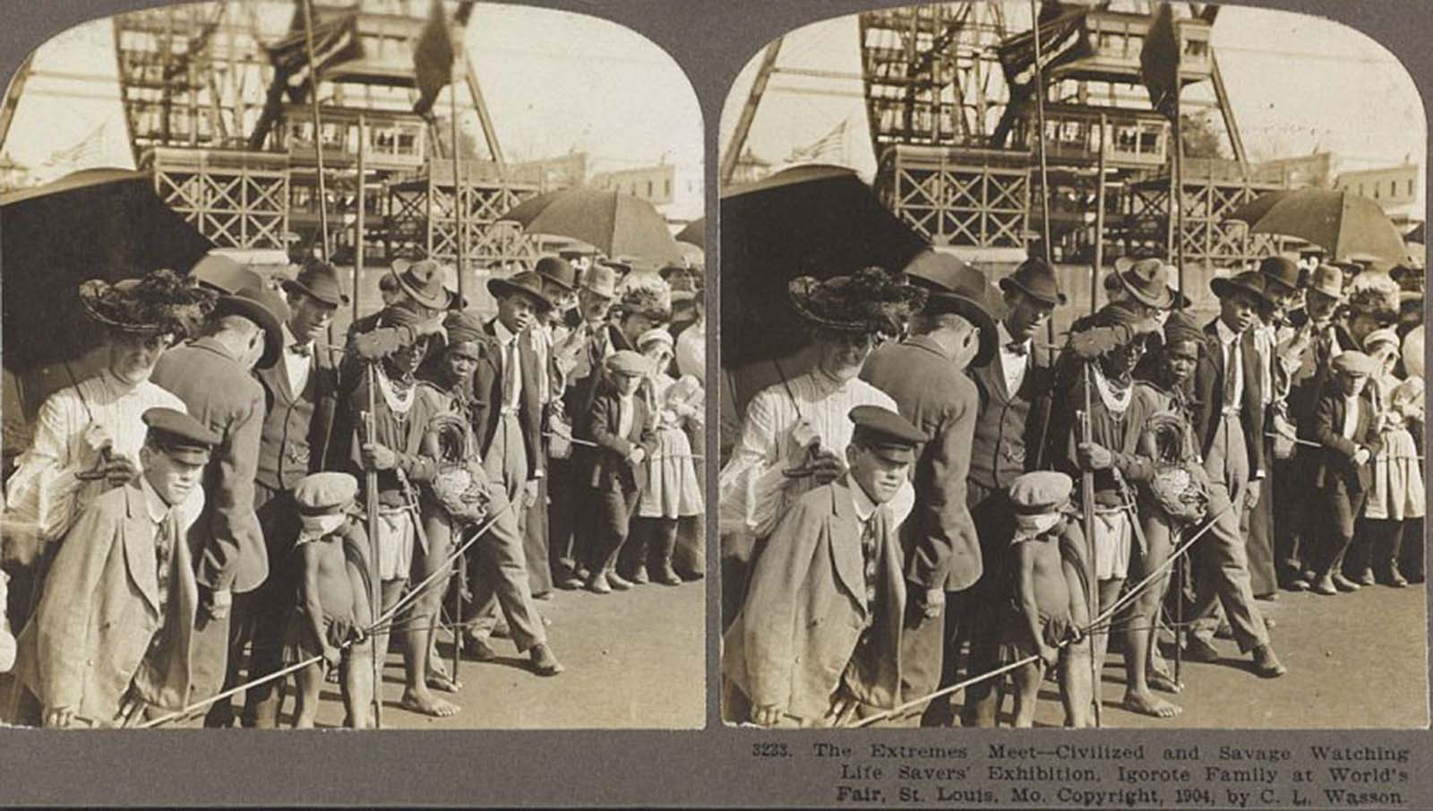 A photograph crudely named 'The extremes meet - civilized and savage watching life savers' exhibition' shows a scene from the World's Fair St. Louis, 1904, with tourists watching people deemed 'primitive'.