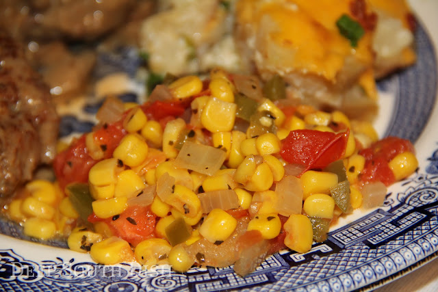 Simple maque choux, a tomatoed corn, is a very simple side dish of tomatoes and corn cooked in sauteed onion and bell pepper.
