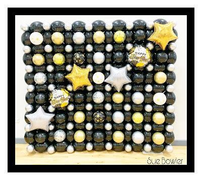 Black, Gold, and Silver New Years Eve Balloon Wall by Sue Bowler
