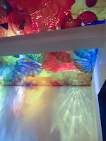 Reflected light from the glass ceiling by Chihuly