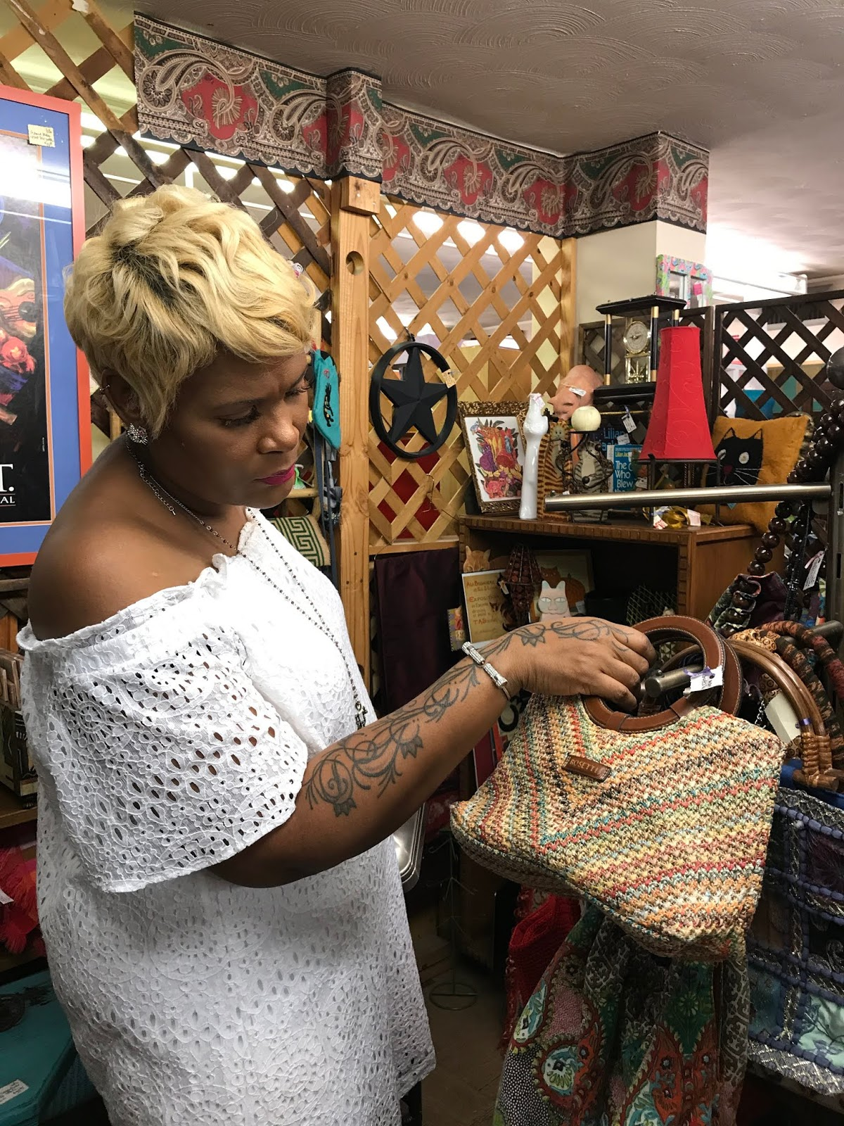 Image: Tangie Bell Holding Bag: Image Woman holding bag at thrift store. Seen First on Bits and Babbles Blog