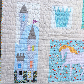 fairytale quilt blocks of a castle, crown and unicorn that are part of the quilt