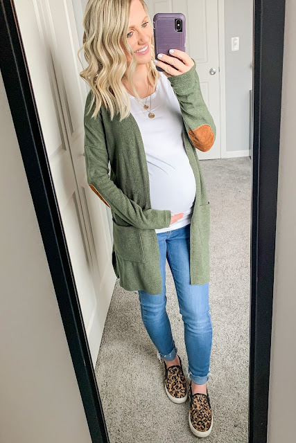 Maternity jean outfit with a green cardigan